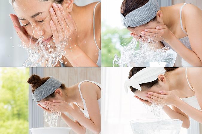 洗面所で顔を洗っている女性